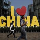 China is putting a positive face on an agreement (Andy Wong/AP)