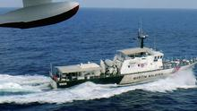 A Malaysian patrol ship searches for Flight MH370.