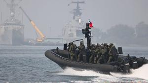 Taiwan special forces carry out a naval drill earlier this year as tensions escalate with neighbouring China. Photo: Reuters/Ann Wang