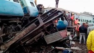Rescuers stand around coaches of a derailed passenger train in Kuneru, Andhra Pradesh, southern India, Sunday, Jan. 22, 2017. Seven coaches were thrown off the tracks around midnight Saturday after a Hirakand Express train derailed, killing over 20 people.  Photo: KK Production via AP