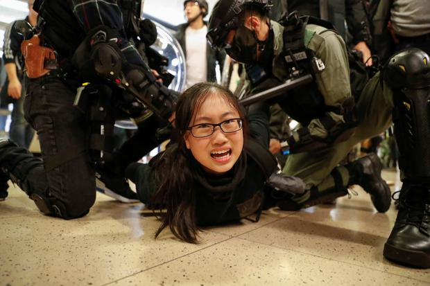Arrest: Police officers detain an anti-government protester during a rally inside a shopping mall in Hong Kong yesterday. Photo: Danish Siddiqui/Reuters