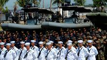 Philippine Marines and Navy sailors stand at attention next to rigid-hulled inflatable patrol boats during the navy's founding anniversary celebration at a naval station in Cavite city, west of Manila on May 25, 2015 . The Philippine navy is one of the weakest in the region relying mostly on decades-old, surplus US warships, but the Philippine government has been modernising the navy and other branches of the armed forces in the face of China's increasing aggressiveness in trying to claim most of the South China sea.