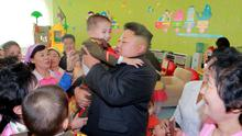 North Korean leader Kim Jong Un visits the Pyongyang Baby Home and Orphanage on New Year's Day in this photo released by North Korea's Korean Central News Agency (KCNA) in Pyongyang