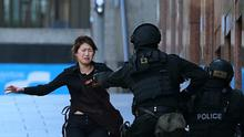 Flashback to Sydney Siege: Cafe employee Bae Jie-un runs to armed tactical response police officers for safety  after she escaped the gunman