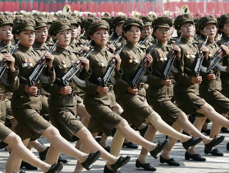 Red Guard members take part in the North Korean parade yesterday.