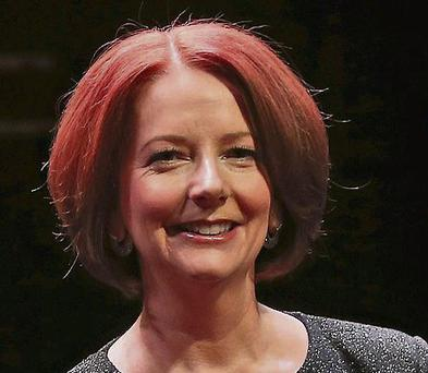 Julia Gillard: called 'witch' and 'bitch' on protesters' banners
