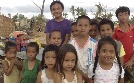 Homeless children in Tacloban in the Philippines wait for the first aid to arrive