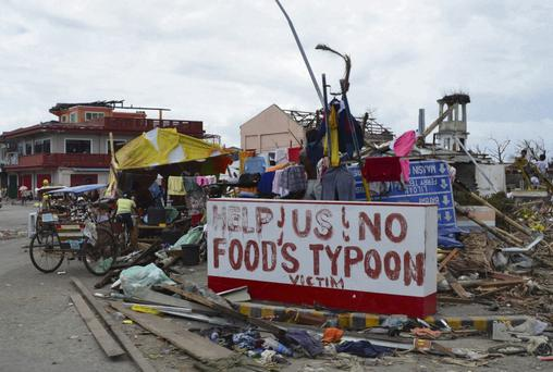 PLEA: A heartfelt message amid the devastation along the main road to Tacloban