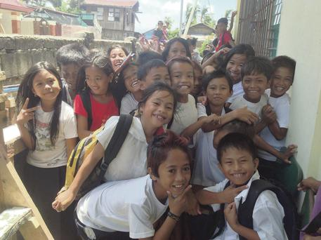 Signs of recovery in the Philippines can be found in the thousands of students attending make-shift classrooms and locals earning money through cash-for-work programmes.