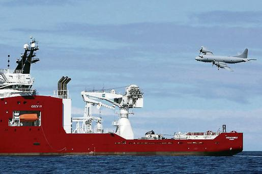 A Royal Australian Air Force (RAAF) AP-3C Orion flies past the Australian navy vessel Ocean Shield as it drops sonar buoys to assist in the search for missing Malaysian Airlines Flight MH370 in the southern Indian Ocean. REUTERS/Australian Defence Force