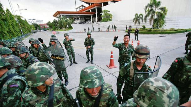 Thai soldiers take control during a coup at the Army Club where Thailand's army chief held a meeting with all rival factions in central Bangkok. REUTERS/Athit Perawongmetha