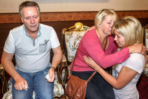 The heartbroken family of Hannah Witheridge, comfort each other in Bangkok.