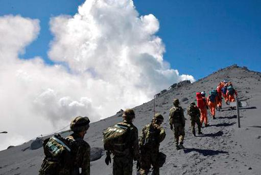 Japan Ground Self-Defense Force (JGSDF), JGSDF personnel and fire fighters head for the summit of Mount Ontake to rescue people who have been trapped in the mountaintop.