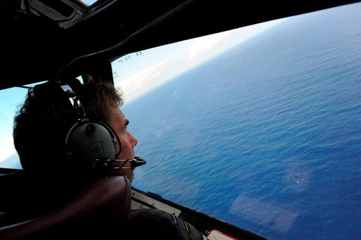 Squadron leader Brett McKenzie looking for objects during the search for missing Malaysia Airlines flight MH370, off the coast of Perth in Western Australia.