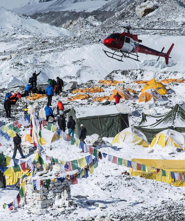 A rescue helicopter is shown at the Mount Everest south base camp in Nepal a day after a huge earthquake-caused avalanche killed at least 17 people (REUTERS/6summitschallenge.com)