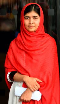 September 3, 2013: Malala Yousafzai, the 16-year-old Pakistani advocate for girls education who was shot in the head by the Taliban in 2012, is pictured before officially opening The Library of Birmingham in Birmingham, central England (Getty Images)