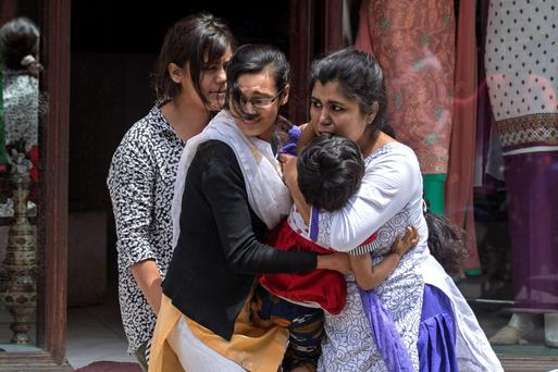 Shocked local residents evacuate from a shop during the earthquake in central Kathmandu, Nepal, yesterday.