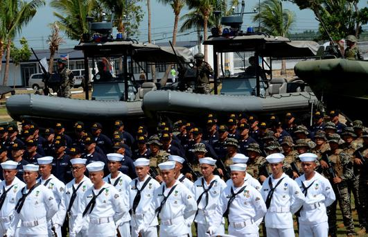 Philippine marines and navy sailors during the navy's founding anniversary celebration at a naval station in Cavite city on Monday. The Philippine government has been modernising the armed forces in the face of China's aggression in trying to claim most of the South China Sea