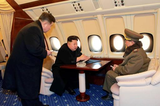North Korean leader Kim Jong -un issues instructions on his plane in this undated photo released by North Korea's Korean Central News Agency in Pyongyang. Photo: Reuters