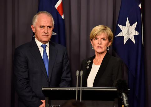 Newly elected Australian Prime Minister Malcolm Turnbull (L) attends a press conference with deputy leader Julie Bishop (R) after ousting Tony Abbot.