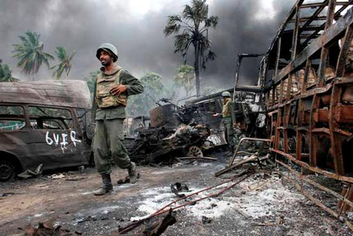 This handout picture received from the Sri Lankan Ministry of Defence on May 18, 2009 is said to be of troops walking amongst debris inside the war zone yesterday, when they h