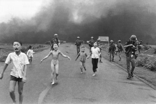 Kim Phuc runs wailing toward the camera after being burned by napalm in Vietnam in 1972