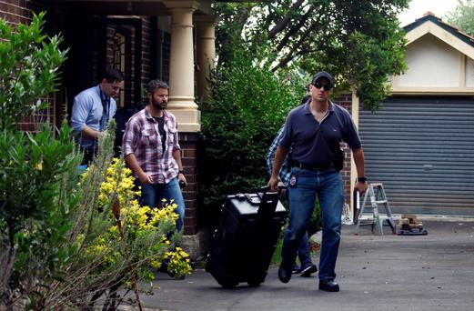Australian police at the home of Craig Steven Wright in Sydney. Photo: Reuters