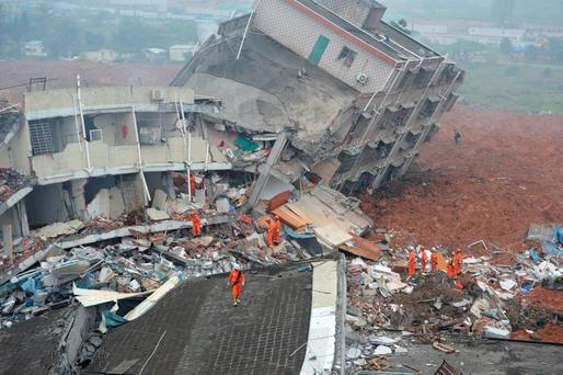 Rescuers look for survivors after the landslide hit an industrial park in Shenzhen in southern China