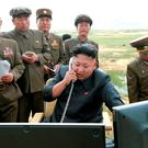 North Korean leader Kim Jong-un guides the test fire of a tactical rocket in this undated file photo released by North Korea's Korean Central News Agency. Photo: Reuters