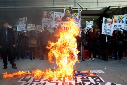 South Korean protesters burn an effigy of North Korea leader Kim Jong-Un during a anti-North Korea rally in Seoul yesterday. Photo: Getty