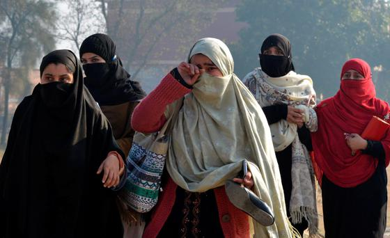 Traumatised students escaping from the Bacha Khan university following an attack by militants in Charsadda, Pakistan. Photo: AFP/Getty Images