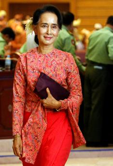 Burma National League for Democracy leader Aung San Suu Kyi arrives to the opening of the new parliament after decades of struggle. Photo: Reuters/Soe Zeya Tu