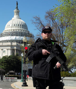 A police officer stands guard at the Capitol Building Photo: Reuters