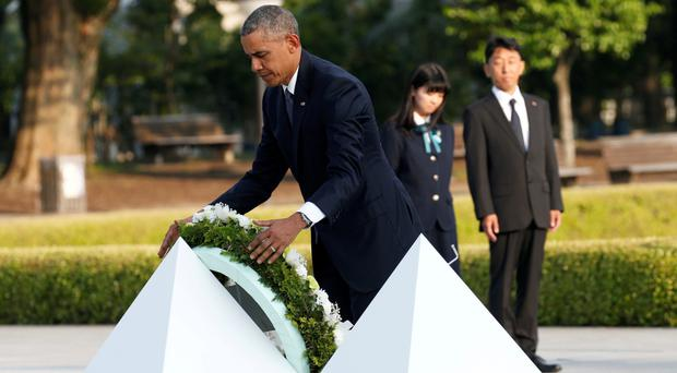 US President Barack Obama lays a wreath during his visit to the Peace Memorial Park in Hiroshima, Japan (Reuters)