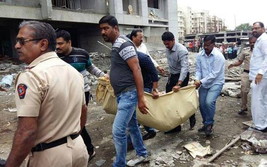 At least eight dead as building collapses in India. Photo: Indian Express