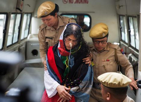 The 'Iron Lady' of Manipur Irom Sharmila is brought to court by soldiers. Photo: Reuters