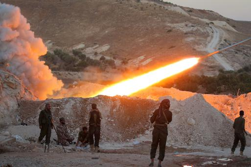 Free Syrian Army fighters launch a Grad rocket from Halfaya town towards President Bashar al-Assad forces stationed in Zein al-Abidin mountain, Syria. Photo: Reuters/Ammar Abdullah