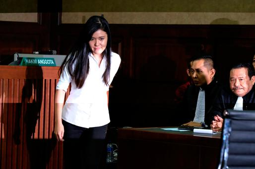 Jessica Kumala Wongso, who is accused of murdering her friend by poisoning her coffee with cyanide, walks after talking with her lawyer during her trial at the Central Jakarta Court in Jakarta, Indonesia. Photo:REUTERS/Beawiharta