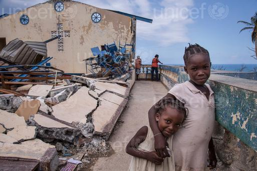 Children outside a church in the Haitian city of Jérémie, where 296 people have sought refuge after their homes were destroyed