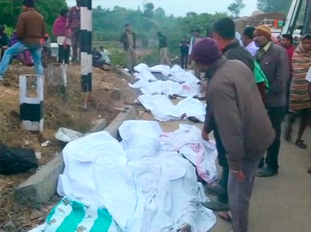 Bodies covered with white sheets are laid out after coaches of a Hirakhand express train from Jagdalpur to Bhubaneswar derailed near Kuneri station, in the state of Andhra Pradesh, outside the town of Rayagada, India, in this still image from video January 22, 2017. Photo: ANI via REUTERS