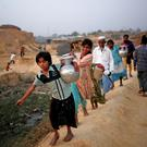 Rohingya refugee girls carry drinking water at Kutupalang Unregistered Refugee Camp, in Cox's Bazar, Bangladesh, yesterday. Photo: Reuters/Mohammad Ponir Hossain