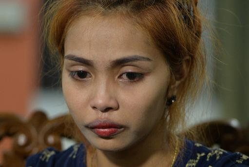 Jiranuch Trirat, mother of 11-month-old daughter Natalie, speaks to the media yesterday. Photo: Reuters