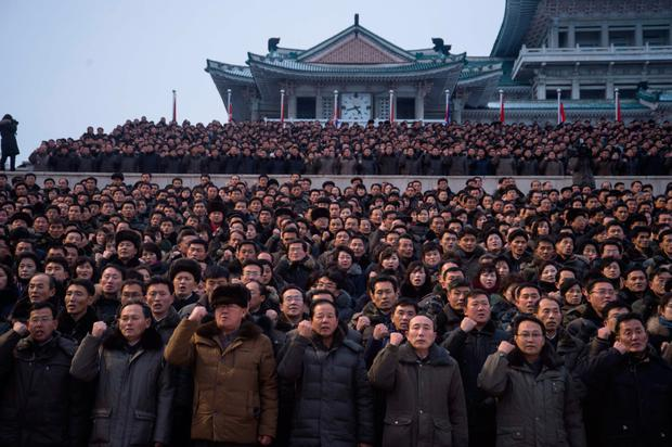Attendees gesture at North Korean leader Kim Jong-un's new year address in Pyongyang yesterday. Photo: Kim Won-Jin/AFP