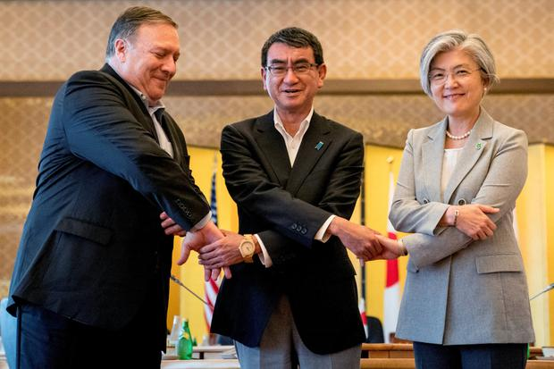 US Secretary of State Mike Pompeo, Japan's Foreign Minister Taro Kono and South Korea's Foreign Minister Kang Kyung Wha shake hands at a meeting in Tokyo. Photo: Reuters