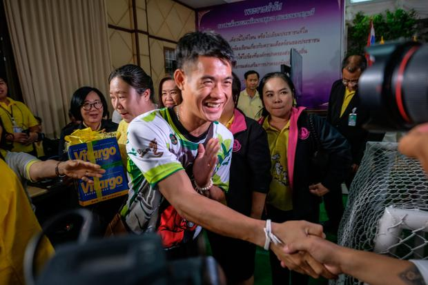 Coach Ekkapol Chantawong, known as Ake, greets a wellwisher at the event. Photo: Getty