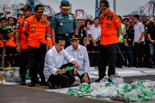 Probe: Indonesian President Joko Widodo holds a personal item from Flight JT 610. Photo: Getty
