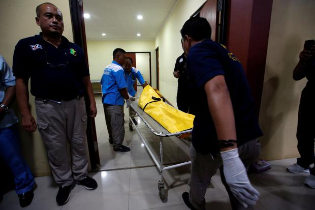 A victim's body arrives in Jakarta to be identified. Photo: Reuters