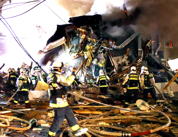 Debris: Firefighters work at the site of the explosion that razed a restaurant in Sapporo in northern Japan. Photo: Reuters