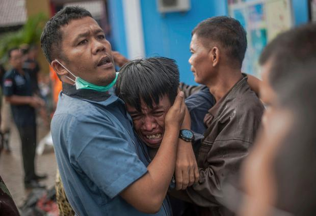 Tragedy: A man reacts after identifying his relative among the bodies in Carita, Indonesia. Photo: AP Photo/Fauzy Chaniago