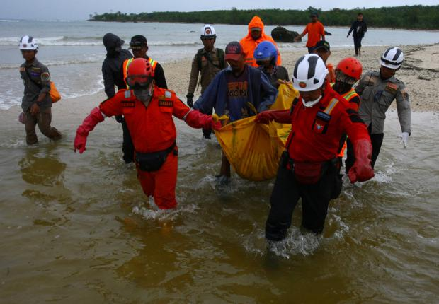 Grim task: Rescue workers carry a body bag of a tsunami victim at Tanjung Lesung, in western Java. Photo: REUTERS